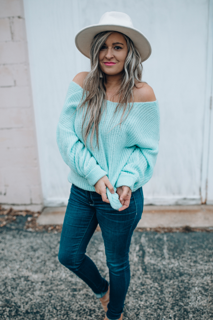 Chicago fashion blogger Happily Inspired shares a cute open back sweater that's under $50! This sweater gave me some of my postpartum blues back!